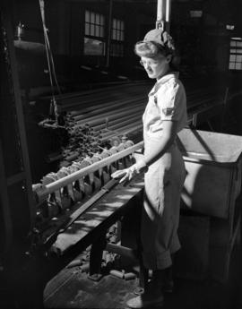 [Woman cutting cardboard tubes at Westminster Paper]