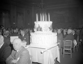 [Huge cake at the Board of Trade's 60th Anniversary banquet]