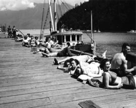 [Sunbathers at Snug Cove Dock]