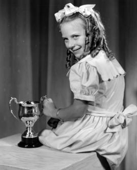 Young girl with trophy