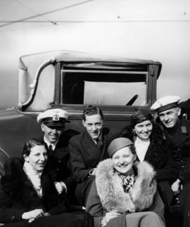 Hugh Pickett and group beside automobile