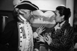 Actor wearing Captain George Vancouver costume talking to unidentified woman