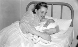 [Mrs. Robert Camp, with her newborn son, Michael Robert, at North Vancouver General Hospital on N...