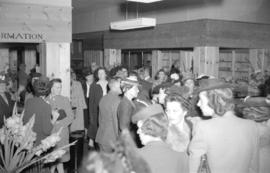 [People gathered in hallway at opening of the Burrard Servicemen's Centre, 636 Burrard Street