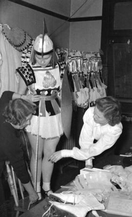 [Woman being fitted for a costume for the Rotary Ice Carnival]