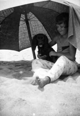 [Mary Louise Taylor and dog at the beach]