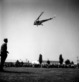 Helicopter hovering over P.N.E. grounds