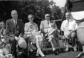 [Howard and Donna Green and others seated outdoors]