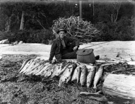 James Crookall with his salmon catch at Bargain Harbour
