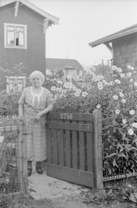 [James Crookall's mother at the gate to 3746 Eton Street]