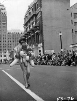 Woman carrying balloons in 1953 P.N.E. Opening Day Parade