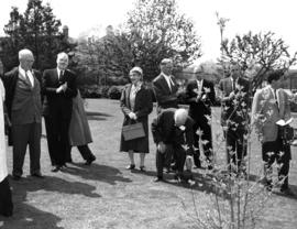 J.S.C. Moffit, B.A. Emery, L.E. Jamieson and group watching the anniversary dogwood tree planting...