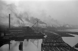 [View of mills and log booms on False Creek]