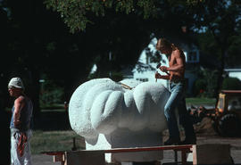 Assistant working on Michael Prentice's sculpture, Prentice on left