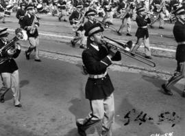 Trombone player marching in 1954 P.N.E. Opening Day Parade