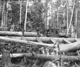 "[""Old Curly"" a former C.P.R. construction locomotive in use for logging]"