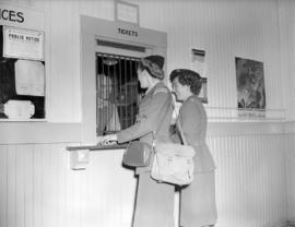 Peace Arch Memorial [members of Womens Transport Service F.A.N.Y. at ticket booth]
