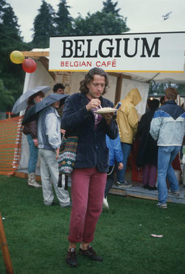 Man walking away from Belgian Café stand at the Food Fair during the Centennial Commission's Cana...