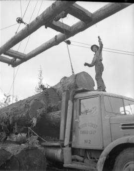 [Loading logs onto a truck for] Pacific Mills [on the] Queen Charlotte Islands