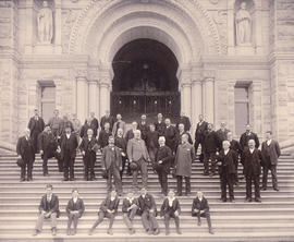 [Group portrait of men and boys on front steps of the Parliament building]