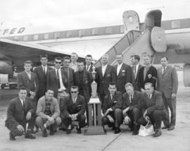 Group portrait of Firefighters soccer team, Kennedy Cup winners, on airport tarmac