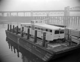 [Canadian Forest Products railcar on a barge in False Creek]