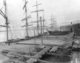[Lumber to be loaded onto tall ships on the wharf at the Brunette Sawmill Company]