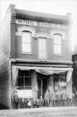 [Yip Sang with children and unidentified men in front of Wing Sang Company building at 51 East Pe...