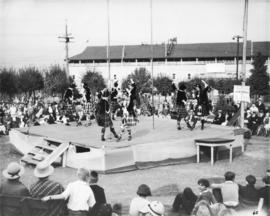 Scottish dancers on outdoor stage, with Grandstand in background