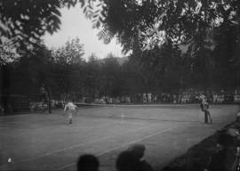 Tennis match and spectators