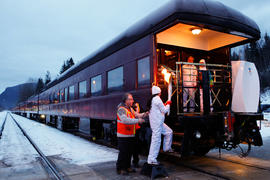 Day 90 Torchbearer 6 Parmjit Bal carries the flame on board a Canadian Pacific Train in Revelstok...