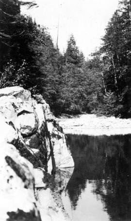 Quiet water below swinging bridge - Capilano river