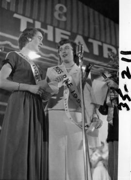 Lynn Adcock, Miss P.N.E. 1953, presenting Nancy Hansen with sash after being named Miss P.N.E. 1954