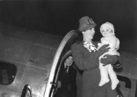 [Mrs. E. Malleck and her daughter Carol Anne prior to boarding an inaugural passenger service of ...