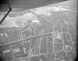 [Aerial view of Vancouver showing the Goodyear blimp]