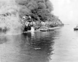 [View of C.P.R. Pier D engulfed in flames]