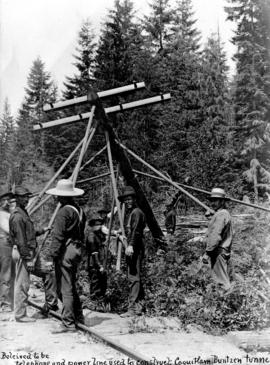 [Men erecting a power pole during construction of the] Coquitlam-Buntzen tunnel