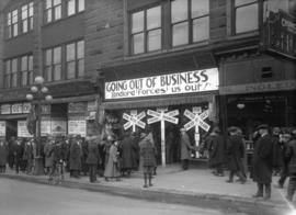 """Going out of business"" sale and crowd at W.S. Charlton Company Ltd."