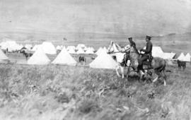 [Soldiers on horses in military camp]
