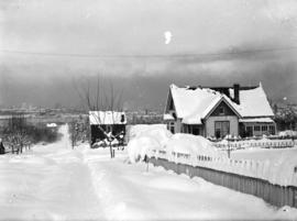 [View of house at 2532 Columbia Street at 10th Avenue, covered in snow]