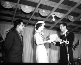 Carol Lucas, Miss P.N.E., receiving box on stage in Mexican Village attraction