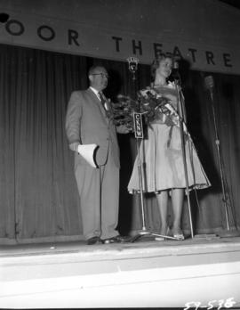 Anna Finlayson, winner of Miss P.N.E. 1959, on Outdoor Theatre stage with P.N.E. director M.L. Barr