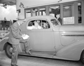 [Woman buying Victory Loan at Lions Gate Bridge toll booth]