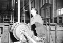 [Woman making a broom handle at the Mohawk Lumber Co., New Westminster]