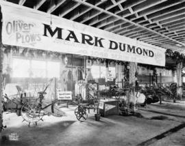 Mark Dumond display of McCormick and Deering farm machinery