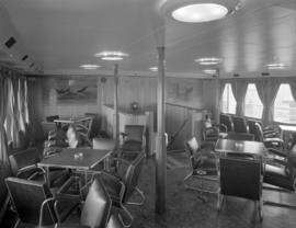 [Interior view of a seating area on board a ship]
