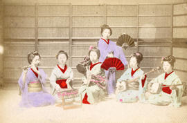 [Studio portrait of six women in traditional Japanese dress with musical instruments and fans]