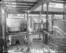 Construction of pan house: interior view of equipment installation