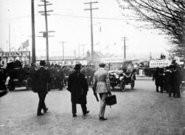 [People heading towards wartime carnival on the Cambie Street Grounds]