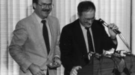 Mike Harcourt and man at podium